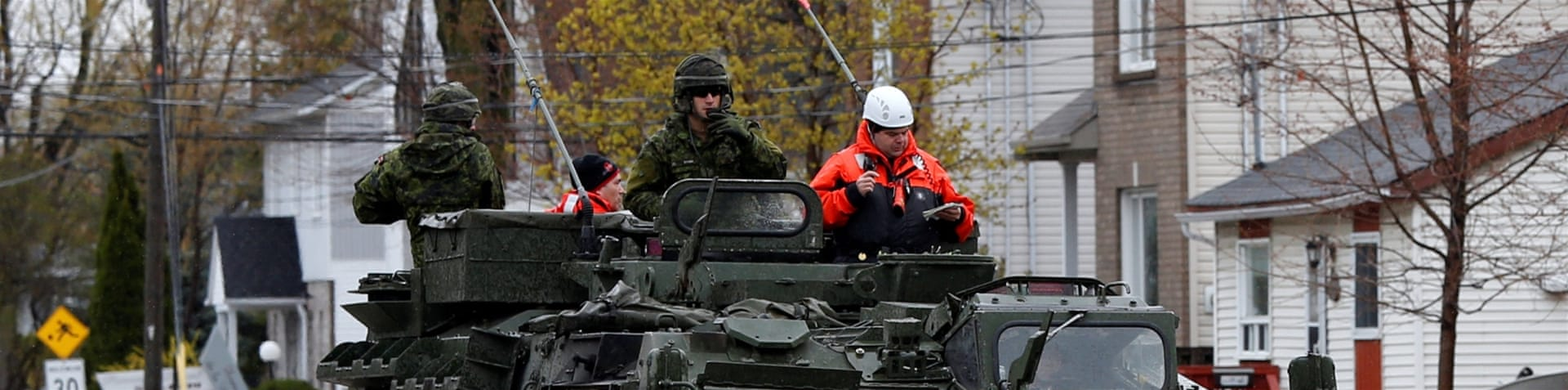 Around 1,200 Canadian forces personnel have been drafted to help with relief [Christinne Muschi/Reuters]