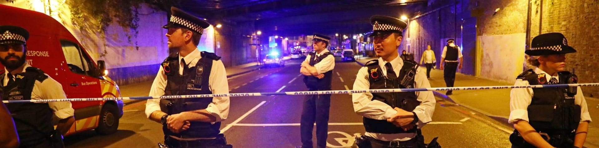 Police are seen near Finsbury Park station after the incident in the early hours of Monday [Neil Hall/Reuters]