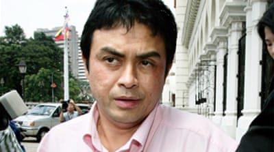 Top aide cleared in Malaysia murder