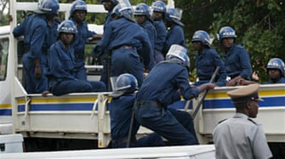 Riot police break up Harare protest