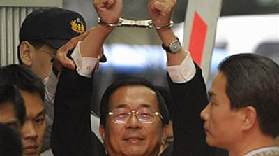 Taiwan leader goes back to jail