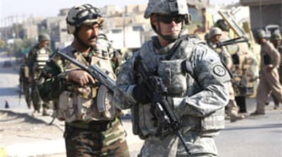 Iraqi PM defends US troop pact