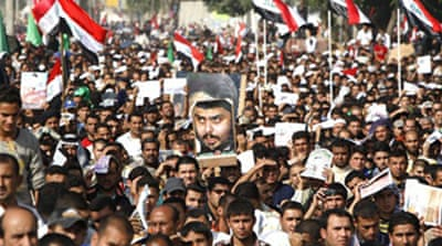 Iraqis hold protest against US pact