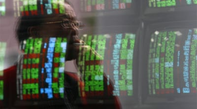 Asian markets defy losses in US