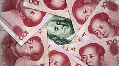 China denies undervaluing yuan