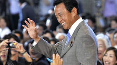 Japan ruling party elects Aso