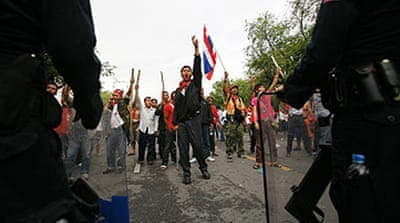 Thai protesters defy emergency law