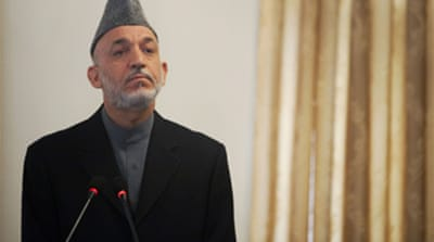 Fraud pushes Karzai to poll runoff