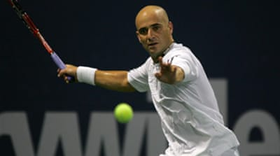 Federer 'disappointed' by Agassi