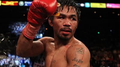 Pacquiao triumphs over Cotto