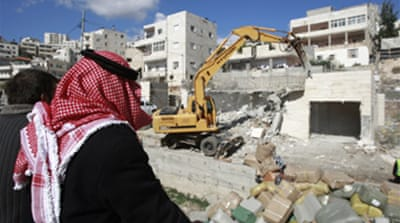 Israel defends settlement expansion