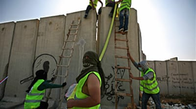 Palestinians break Israel's wall