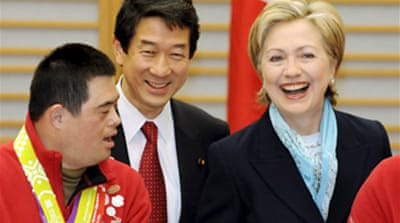 Clinton lands in Tokyo on Asia tour