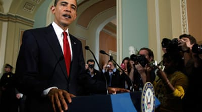 Obama pushes $900bn stimulus bill