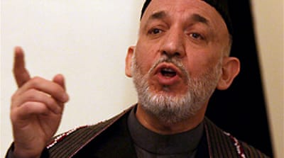 Hamid Karzai calls for early poll