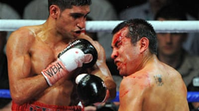 Khan leaves Barrera bloodied