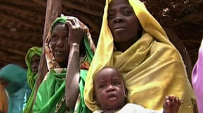 Sudan to allow return of Darfur aid