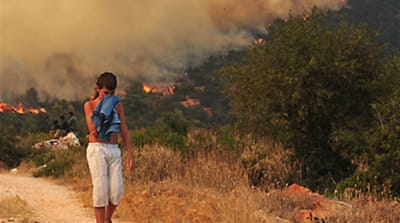Wildfires rage around Greek capital