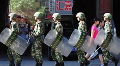 China to begin Xinjiang riot trials