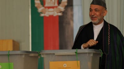 Early results give Karzai slim lead