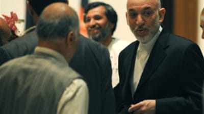 Karzai widens early poll lead