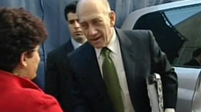 Video: Olmert charged with fraud