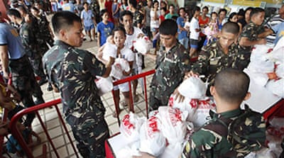 Toll rises in Philippine floods