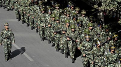 China dismisses Xinjiang officials