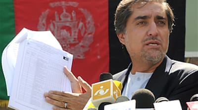 Karzai rival backs Afghan runoff