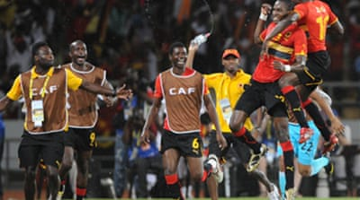 Angola beat Malawi to go top