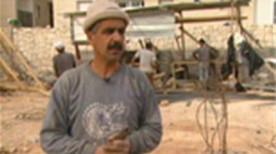 Palestinians build Israeli homes