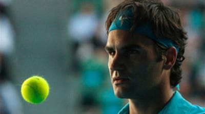 Cool Federer fires past Davydenko