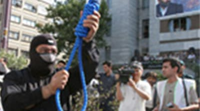 Iran executes two over poll unrest