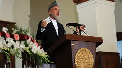 Karzai firm on private security ban
