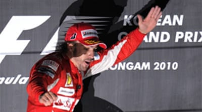 Alonso leaps into F1 title lead