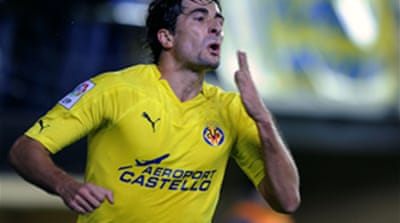 Villarreal keep Real in sight