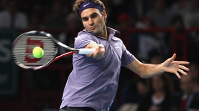 Federer eases past Gasquet