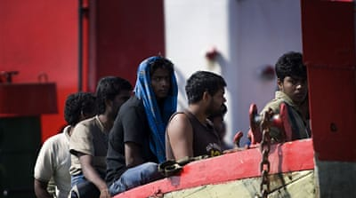 Australian asylum seekers sew lips