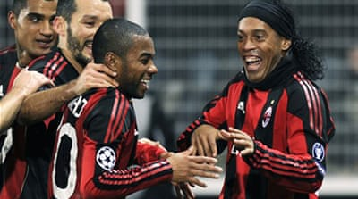 Milan advance in Champions League