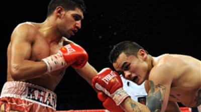 Khan edges Maidana in thriller