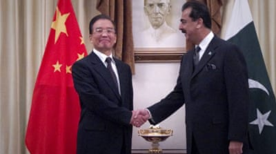 China, Pakistan sign for billions