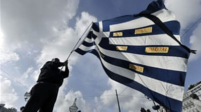 Greek lawmakers pass tough budget