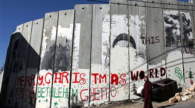 Scaling a wall: Santa in Palestine
