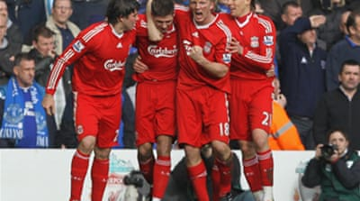 Kuyt shines for 10-man Reds