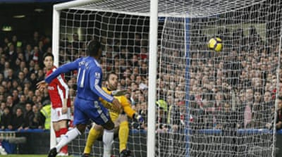 Drogba double sends Chelsea top