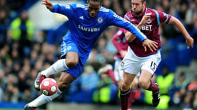 Drogba fires Blues back to the top