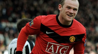 Rooney retakes summit for United