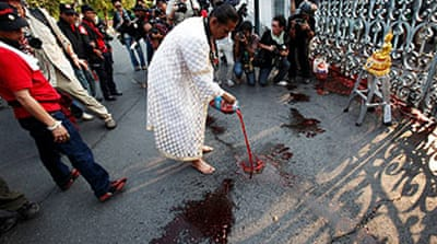 Red shirts take blood protest to PM