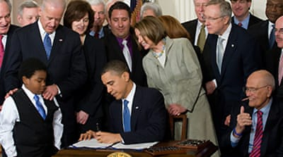 Obama signs health bill into law