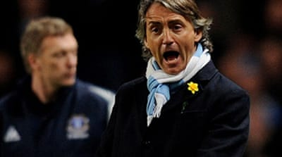 Mancini off as Man City lose